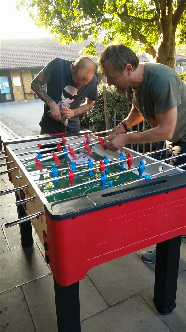 Foosball table being assembled